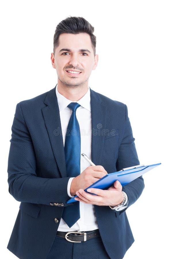 快乐的推销员画象有采取笔记的剪贴板的 库存图片