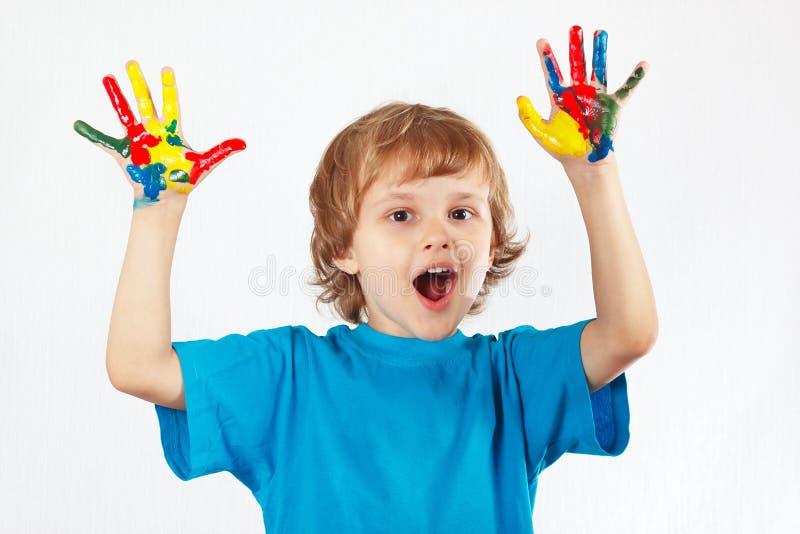 快乐的男孩用在白色背景的被绘的手 库存照片