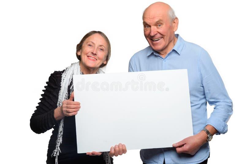 快乐的老年迈的夫妇举行招贴 库存图片