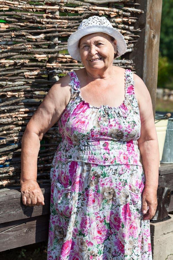快乐的资深妇女画象在夏天 图库摄影