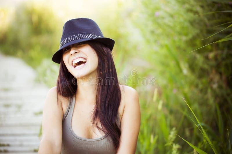 有帽子的快乐的妇女 库存照片