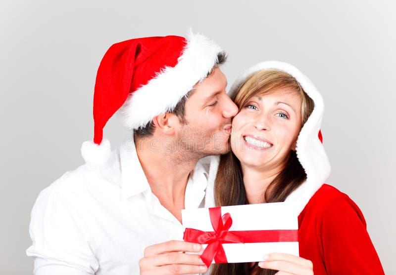 快活圣诞节的夫妇 图库摄影