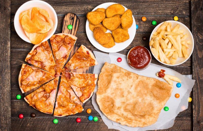快餐或速食背景顶视图 免版税库存图片