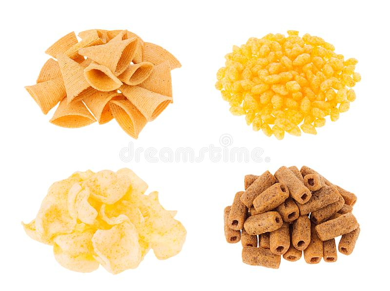 快餐汇集-嘎吱咬嚼的另外玉米在被隔绝的堆黏附在白色背景 库存图片