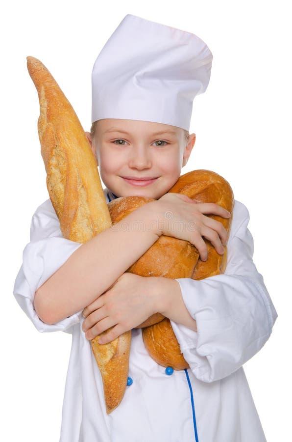 快活的面包师用三个面包 库存图片