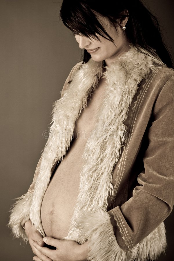 怀孕的乌贼属定调子妇女 免版税库存图片