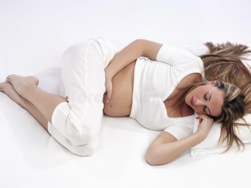 怀孕的休眠的妇女 库存照片