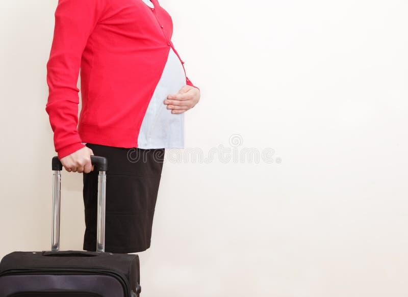 怀孕的女实业家旅行 库存照片