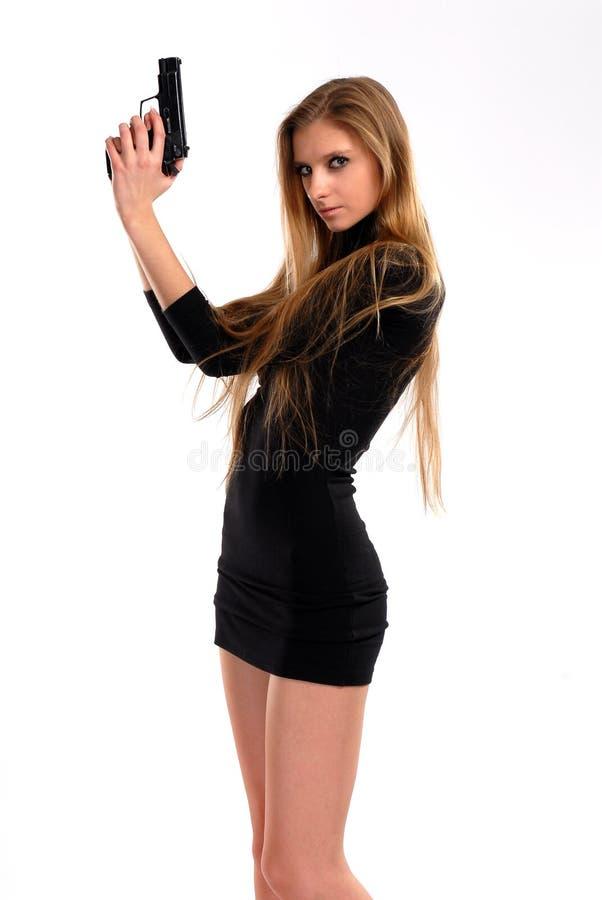 性女孩的手枪 免版税库存图片