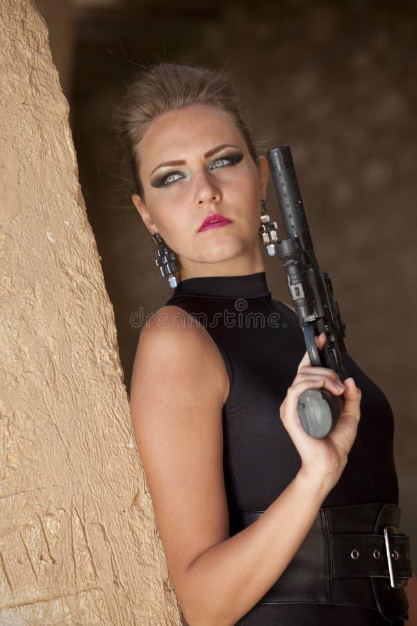 性感女孩的枪 库存图片