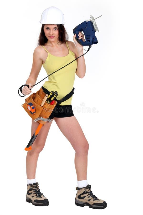 性感女工匠摆在 免版税库存照片