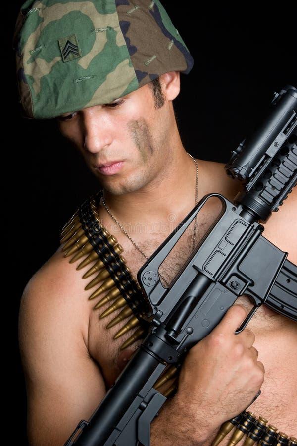 性感枪的人 免版税图库摄影