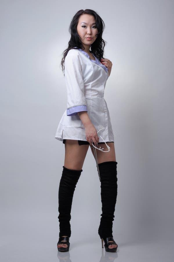 年轻性感的亚裔护士 免版税图库摄影