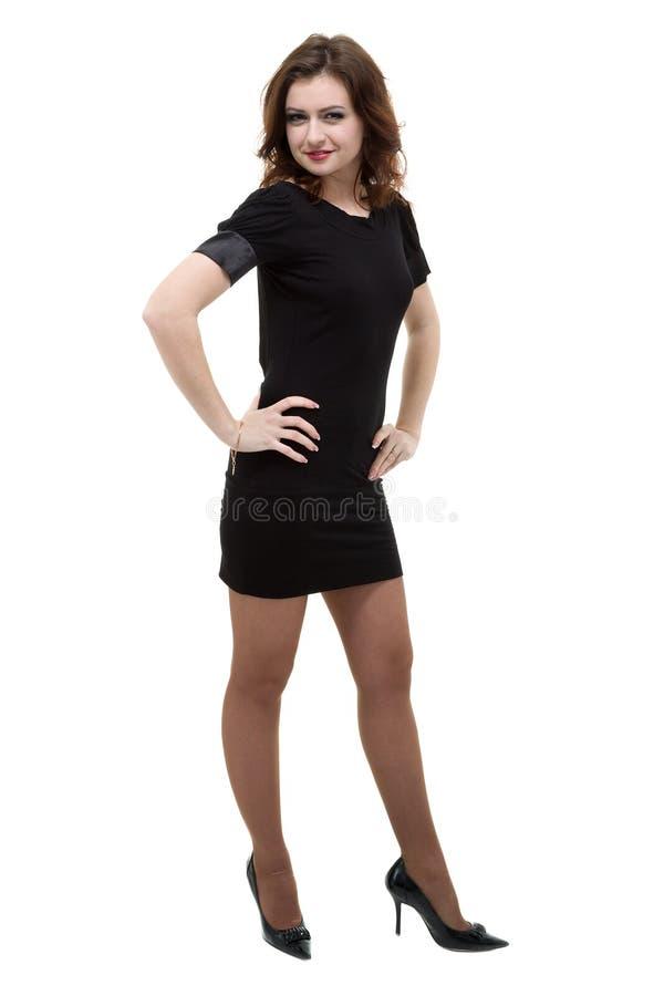 性感的妇女全长射击一点黑礼服的,隔绝在白色 免版税库存图片