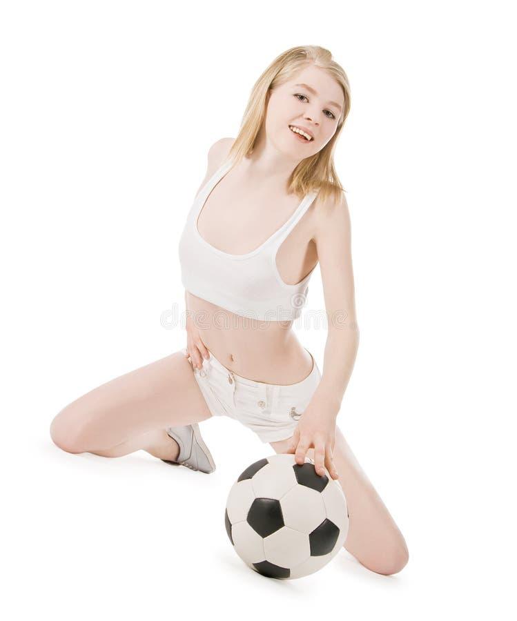 性感的妇女的图片有足球的在白色 图库摄影