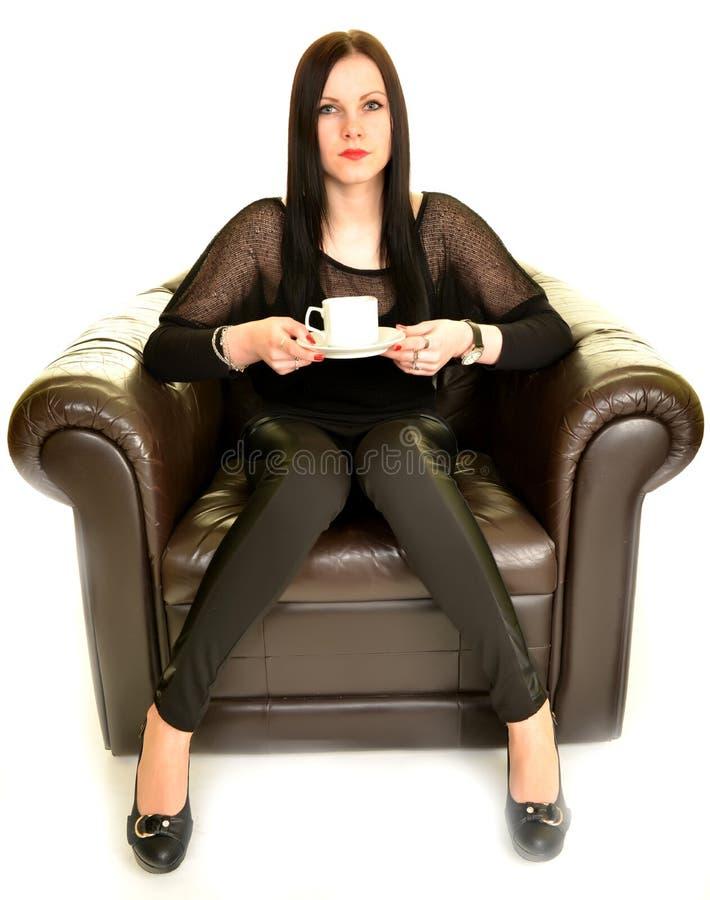 性感的妇女饮用的咖啡 免版税库存照片
