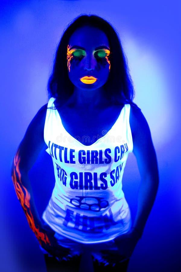 性感的妇女紫外光氖组成秀丽 免版税库存照片