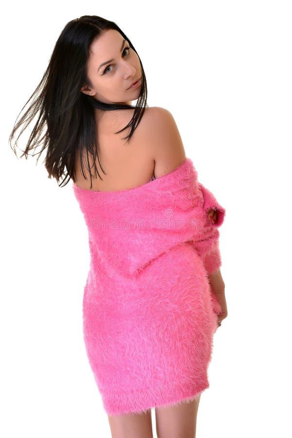 性感的嬉戏的妇女佩带的桃红色 库存图片