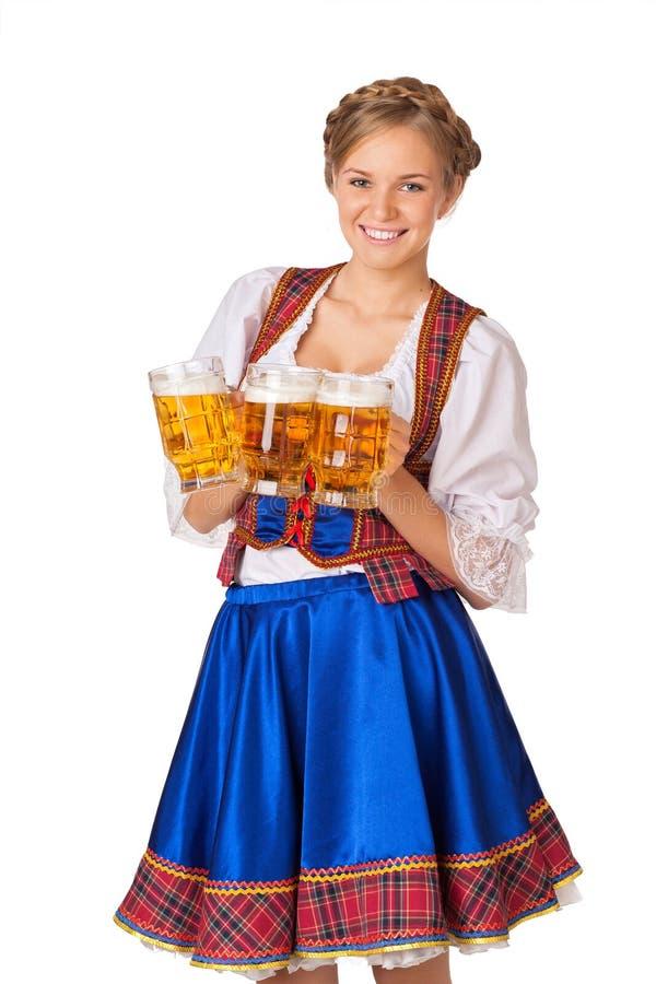 年轻性感的慕尼黑啤酒节妇女 库存照片