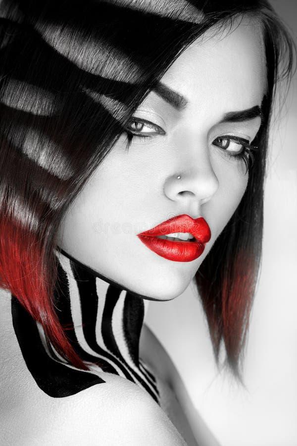 性感的白种人妇女成为不饱和的画象有红色嘴唇的 库存图片