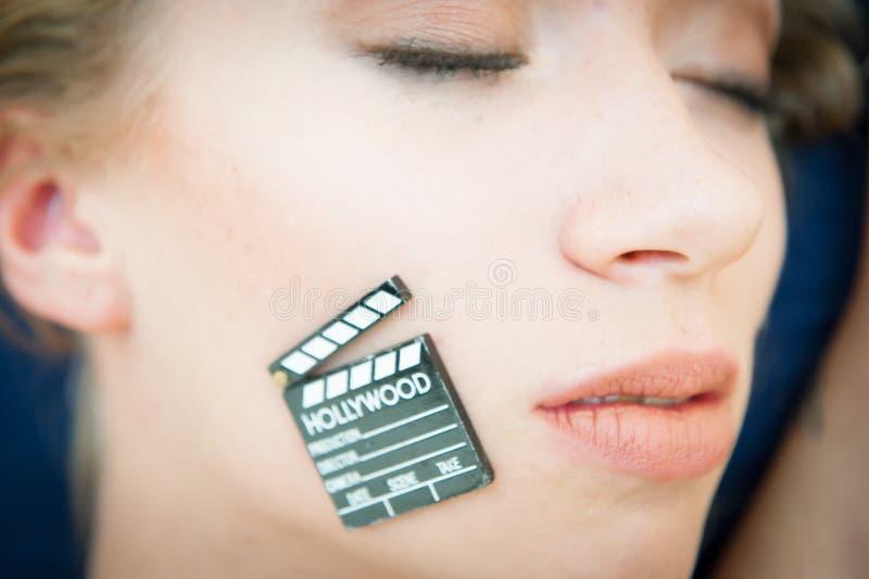 性感的白肤金发的妇女面孔标志色情成人电影 免版税库存照片