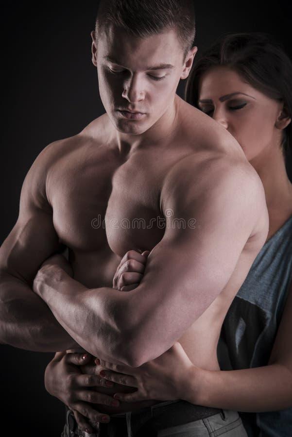 性感的肌肉赤裸人和女性现有量 库存图片