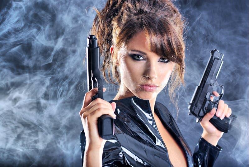性感美好的女孩枪的藏品 免版税库存照片