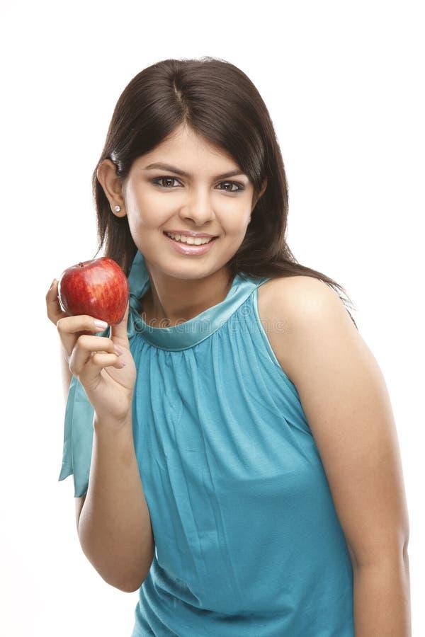 性感苹果的女孩 免版税库存照片