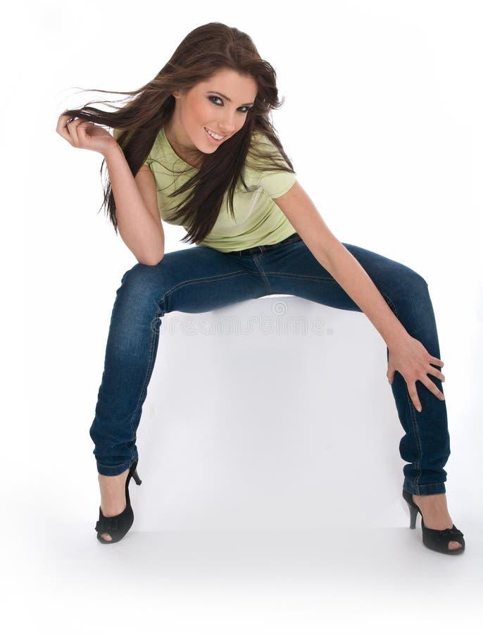 性感蓝色女孩的牛仔裤 免版税库存照片