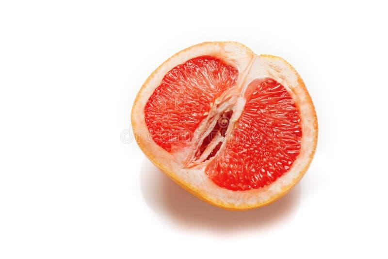 性葡萄柚,概念 阴道和阴蒂标志 库存照片