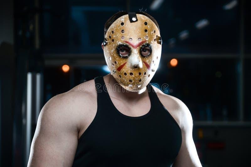 恐怖残酷贾森面具人坚强的爱好健美者运动健身 免版税库存图片