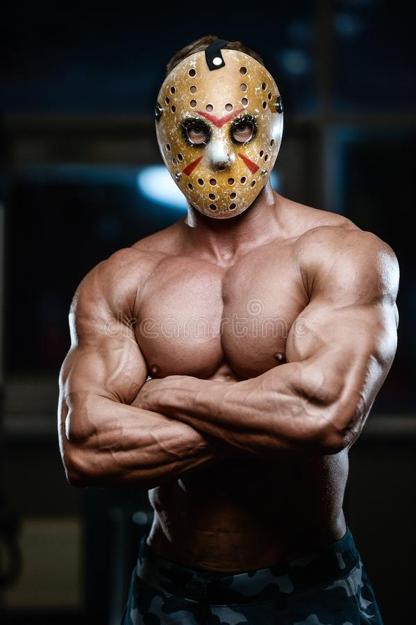 恐怖残酷贾森面具人坚强的爱好健美者运动健身 免版税库存照片
