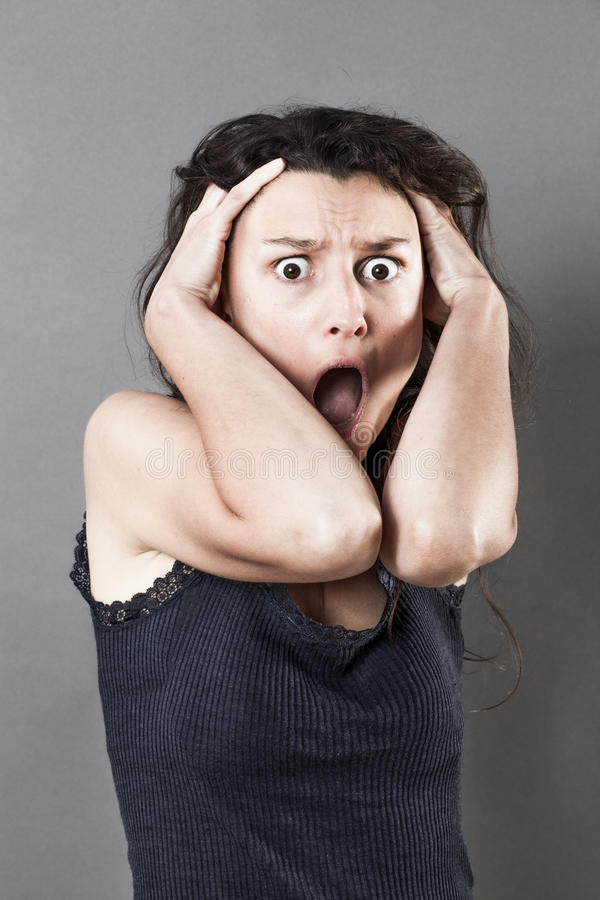 恐慌害怕的妇女表达震惊 图库摄影