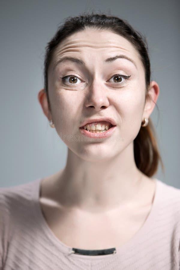 恶心的妇女画象  免版税库存图片