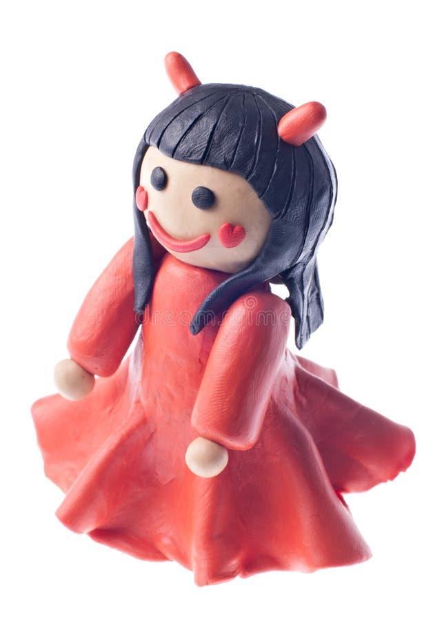 恶魔滑稽的女孩彩色塑泥 免版税库存照片