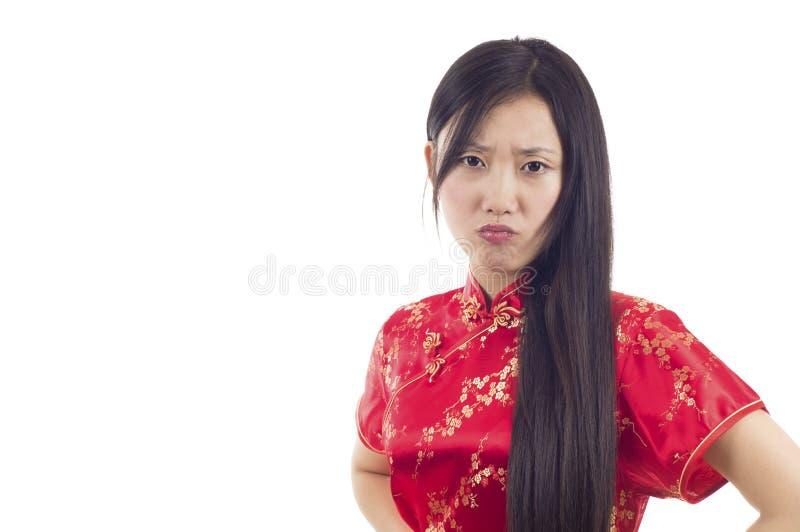恼怒的亚裔妇女 图库摄影