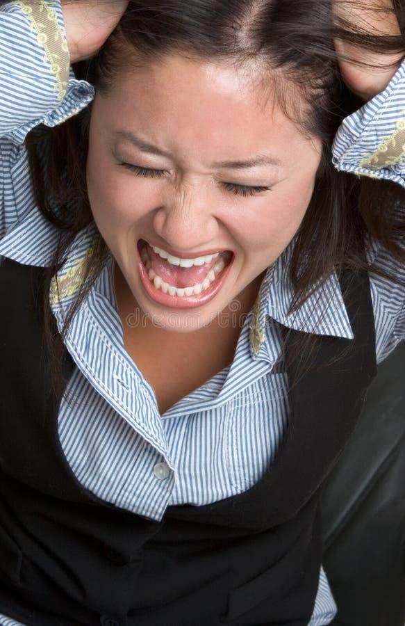 恼怒的亚裔妇女 免版税库存照片