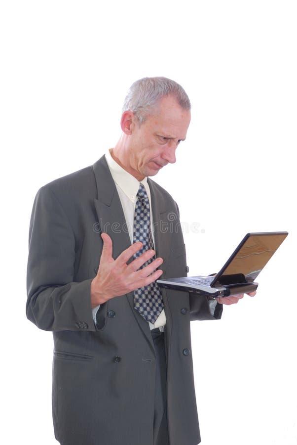 恼怒的企业膝上型计算机人 库存照片
