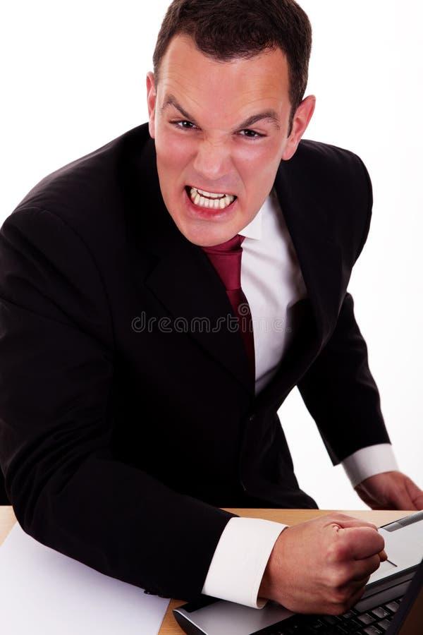恼怒的商人纵向 库存图片