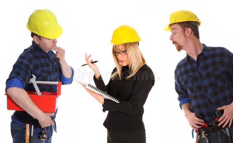 恼怒的女实业家建筑工人 库存图片