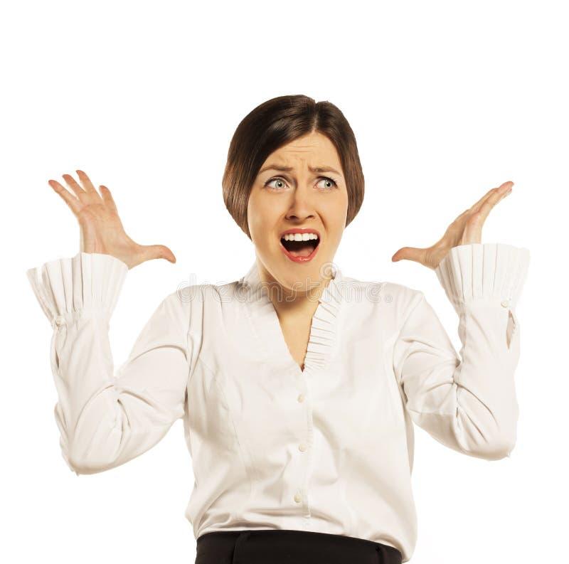 恼怒的女实业家,隔绝在白色 库存照片