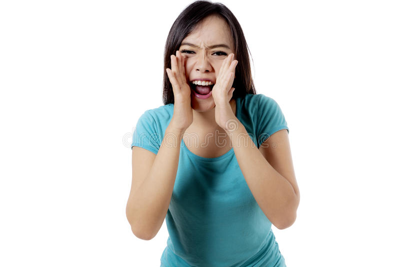 恼怒的妇女通过手是叫喊的 库存图片