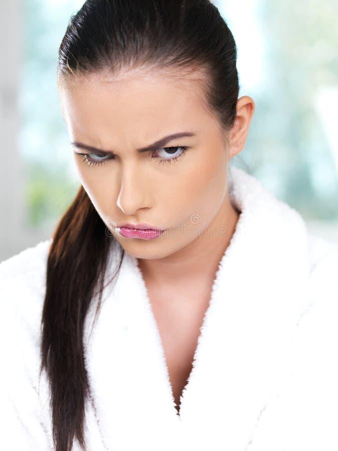 恼怒的妇女年轻人 免版税库存照片