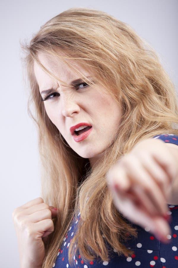 恼怒的妇女 免版税库存图片