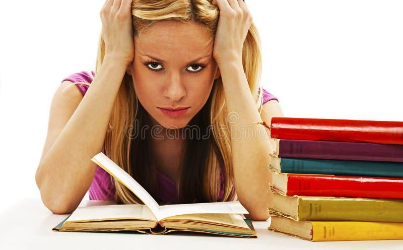 恼怒的学生女孩有学习困难 图库摄影