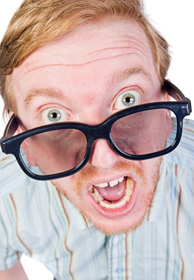 恼怒的怪杰玻璃朝向红眼圈厚实 免版税库存照片