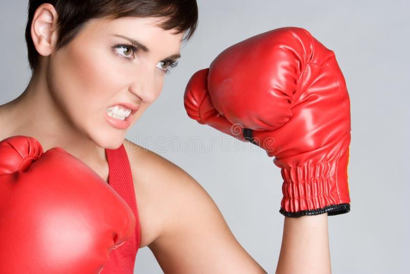 恼怒的拳击妇女 库存照片