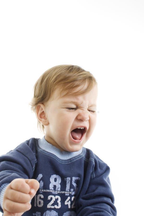 恼怒的男婴纵向 图库摄影