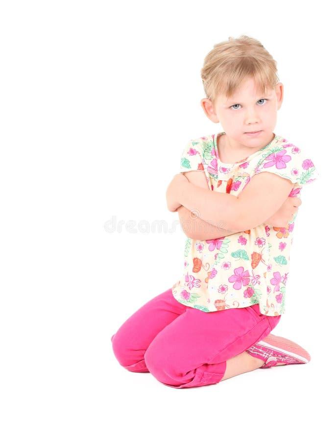 恼怒的白肤金发的女孩头发一点 库存图片