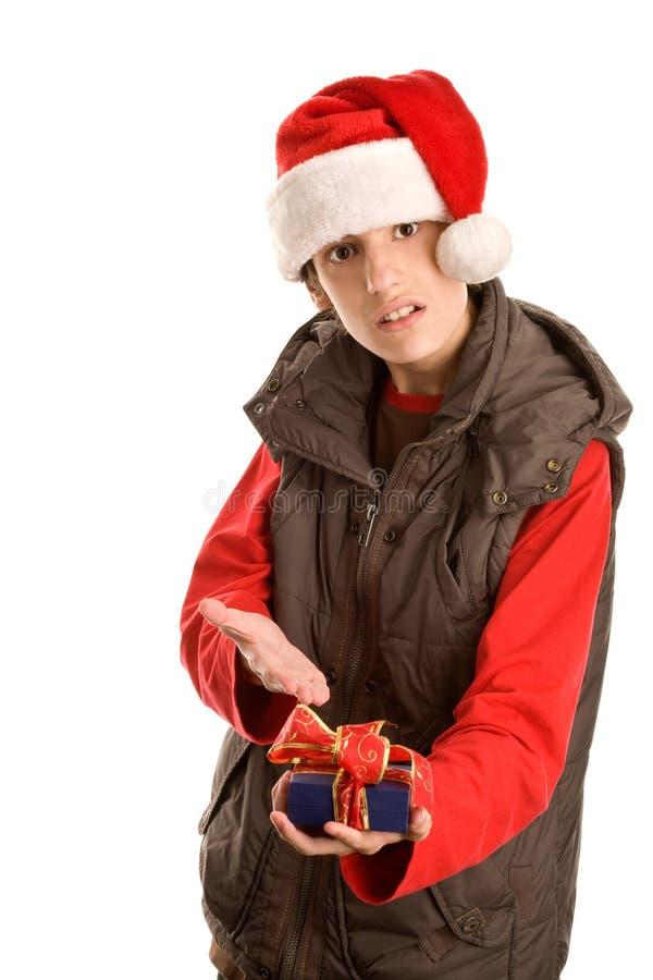 恼怒的礼品人不需要的年轻人 库存照片